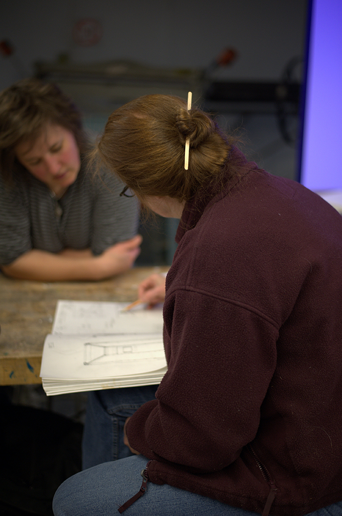 Student and professor visit Sculpture classroom
