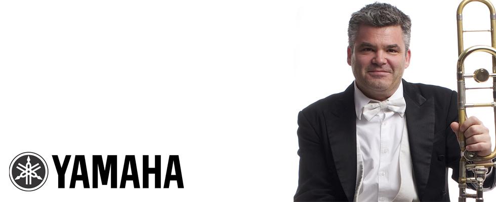 Photo of Peter Sullivan and the Yamaha logo