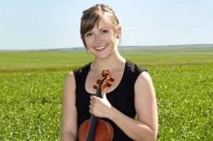 Violinist in field