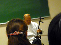Mr. Tao playing a traditional  Chinese instrument