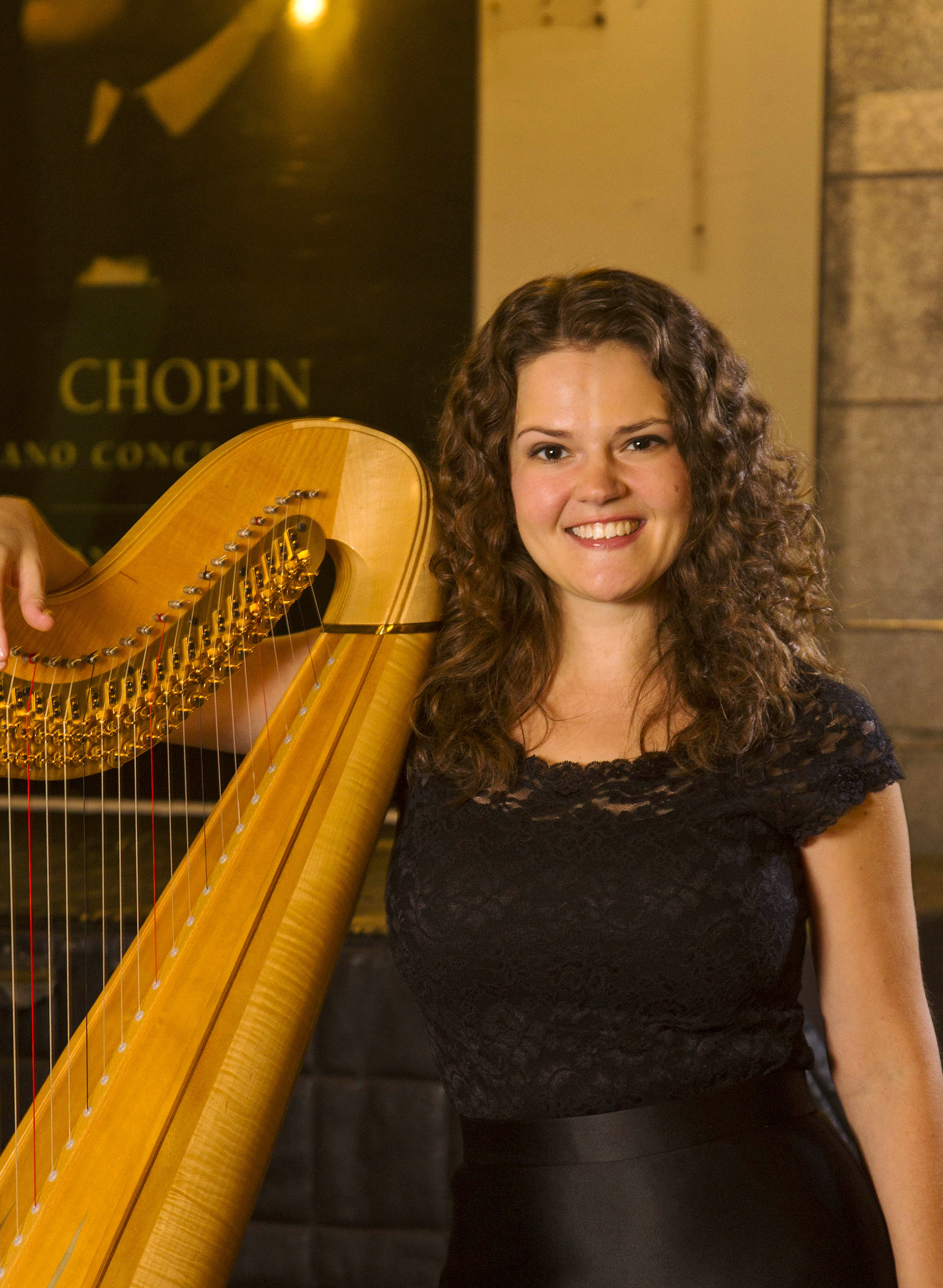 Photo of Allegra Lilly with harp