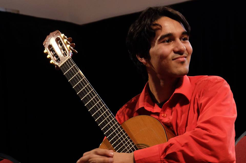 Photo of Daniel Ramjattan with guitar