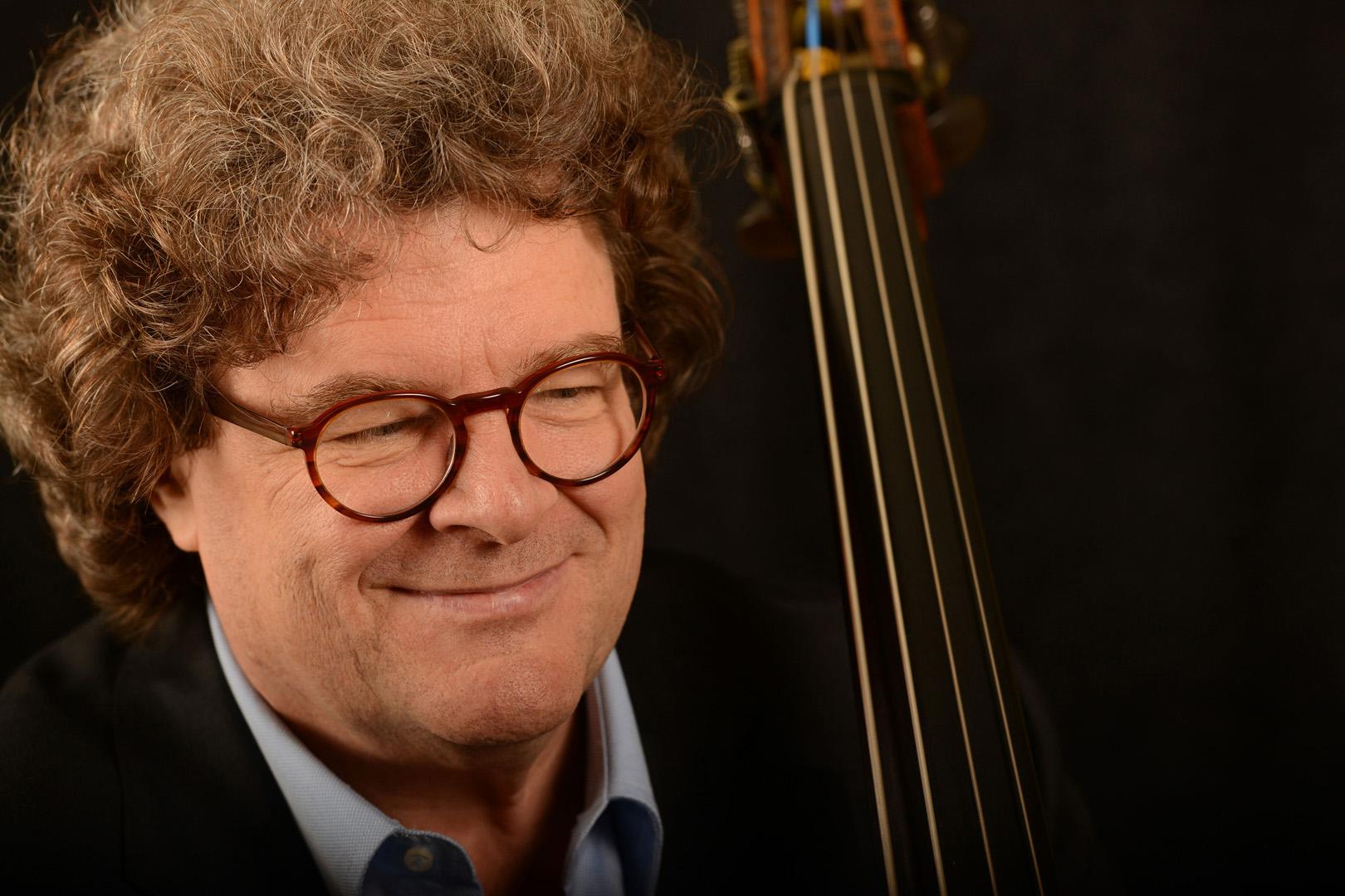 Head shot of Joel Quarrington with double bass