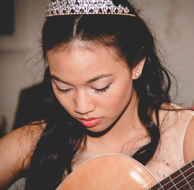 Megan Romano photo playing guitar
