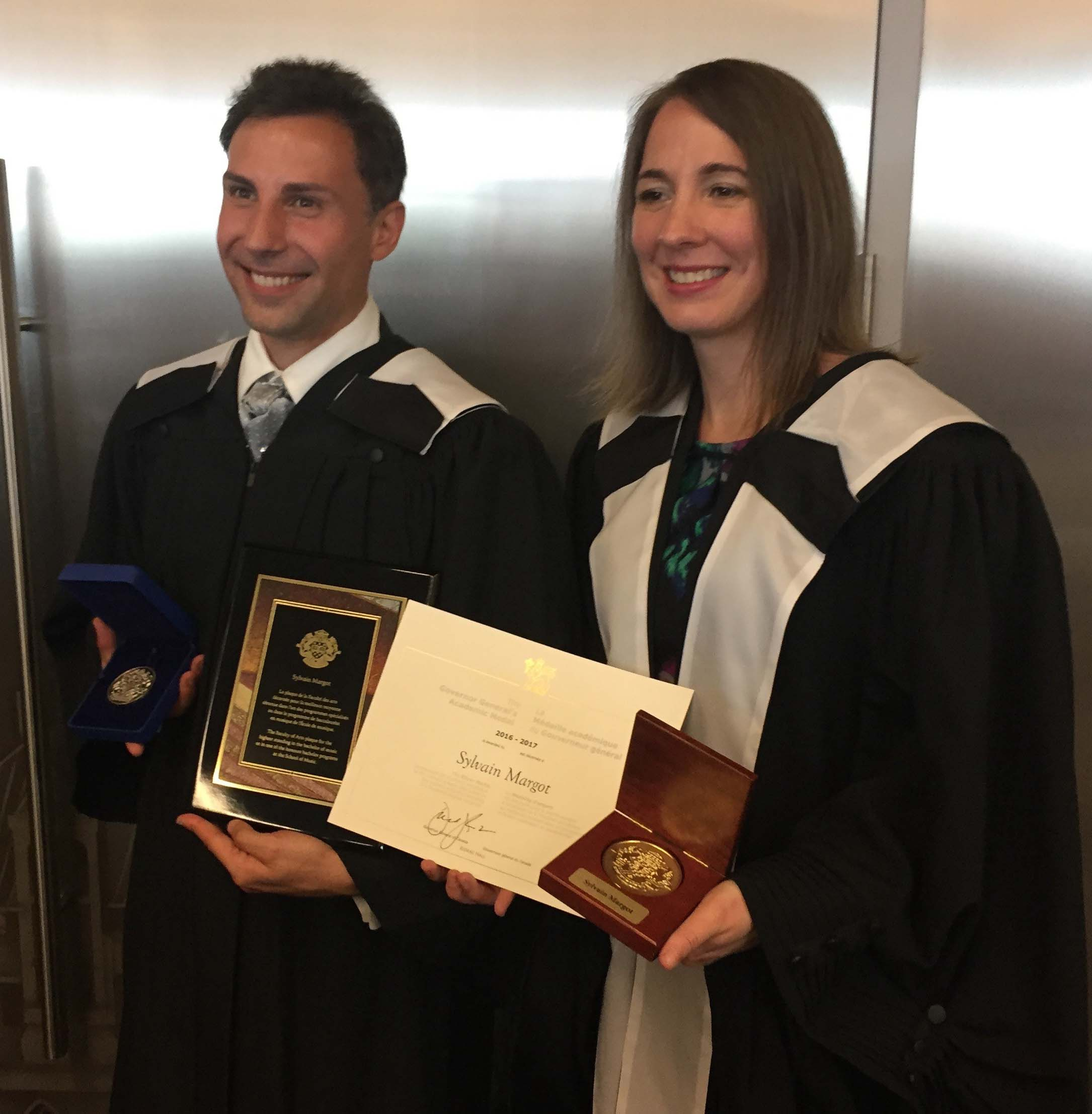 Sylvain Margot and Professor Julie Pednault Deslauriers pictured with his medals
