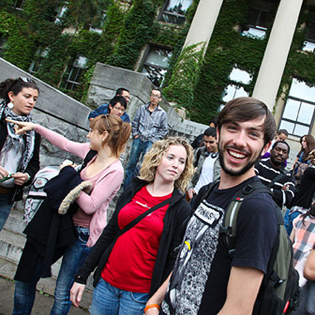 An enthusiastic crowd of students during an event on campus